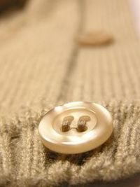 How to Sew Buttons on Knitted Items thumbnail