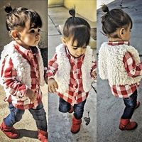 Plaid, fur, and little red boots!