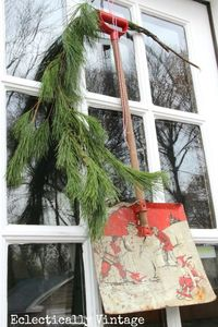 It's business on my front door�€� and a party on my back door! Two wreaths. Both using vintage finds. Old wooden finials from a house so the rain could drip gentl