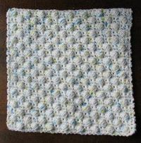 Try your hand at a new crochet stitch today! Make a Ball Stitch Dishcloth with this free crochet pattern; the balls are stitched right into the dishcloth making