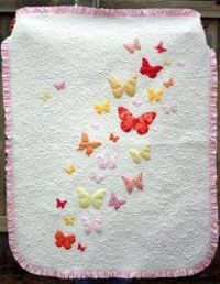 Butterflies a Flutter Baby Quilt Pattern/Tutorial - applique quilt. This might be especially cool with trapunto too....