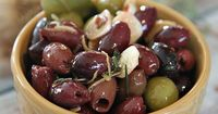 Don't pay olive bar prices when you can make your own marinated olives with a vinaigrette with ingredients you probably already have in the house!