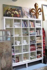 According to BRASWELL: Facelift for a IKEA Expedit Bookcase. added moulding to top and bottom, and added legs