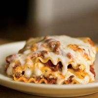 Baked Lasagna uses uncooked noodles. Says best ever recipe