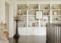 love the idea of this.......long bookcase built-ins in hall way leading to bedrooms