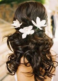 half up with flowers (but not these) in my hair. undone, but done